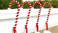 Candy Cane Stocking Holders in Velvet by Haute Decor.